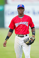 Kannapolis Intimidators shortstop Tim Anderson (2) warms up in the outfield prior to the game against the Greensboro Grasshoppers at CMC-Northeast Stadium on July 13, 2013 in Kannapolis, North Carolina.  The Intimidators wore throwback jerseys of the Piedmont Boll Weevils, who played in Kannapolis from 1996-2000.   (Brian Westerholt/Four Seam Images)