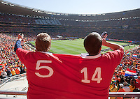Two Denmark fans wearing a large jersey chant and have a drink of beer before their FIFA World Cup first round match at Soccer City in Johannesburg, South Africa on Monday, June 14, 2010.