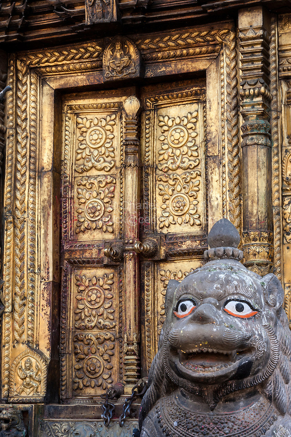 Nepal, Changu Narayan Temple, Western Entrance, before April 2015 earthquake.  The temple was heavily damaged in the earthquake, but will be repaired.  This shows one door of the torana, the elaborate brass gateway to the temple.
