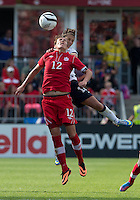 02 June 2013: U.S .Women's National Team player Carli Lloyd #10 battles with Canadian Women's Nation Team player Christine Sinclair #12 during an international friendly soccer match between the U.S Women's National Team and the Canadian Women's National Team at BMO Field in Toronto, Ontario Canada.<br /> The U.S. National Women's Team won 3-0.