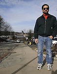 NAUGATUCK, CT -04 JANUARY 2007 -010408DA03- Dan Whitman stands on a deteriating sidewalk in front of the $4,000 sidewalk he built at his Naugatuck residence after local officials told him he would be responsible for. Three years later the town is fixing all the sidewalks on his street and ripping up the sidewalk he built.<br /> Darlene Douty/Republican-American