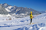Austria, Tyrol, Kaiserwinkl, Walchsee: ski lift, view at Walchsee, skiing instructor with class on the ski run