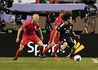CHICAGO, IL - JULY 7: Michael Bradley #4 defends against Rodolfo Pizarro #20 during a game between Mexico and USMNT at Soldiers Field on July 7, 2019 in Chicago, Illinois.