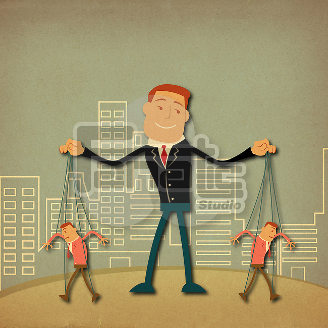 Businessman controlling workers as puppets