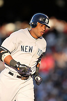New York Yankees second baseman Robinson Cano #24 runs the bases after hitting a home run against the Los Angeles Angels at Angel Stadium on June 4, 2011 in Anaheim,California. Larry Goren/Four Seam Images
