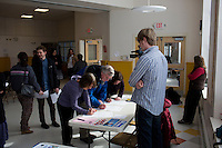 People sign their names to get candidates on the ballot for the 2014 election before the Portland Democratic City Committee town caucus in the East End School cafeteria in Portland, Maine, USA, on March 3, 2014. Candidates presented their positions to the public and also gathered signatures required to get them listed on the ballot. The town caucus had speeches from various other local candidates and also served to choose delegates for the 2014 Maine State Democratic Caucus.