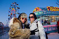 Two youths enjoying their time at the carnival during Fur Rondy Festival, downtown Anchorage.