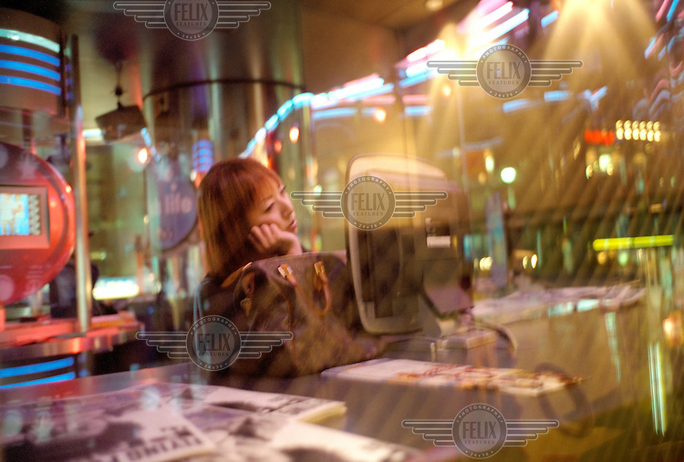A girl at an internet cafe in Shibuya.