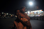 Alamgir and his new girl friend Radha at the Sealdah railway premises. Alamgir is staying here for last 6 years from the time he ran away from his home due to domestic violence and poverty. As per his version his father was a drunkard and used to beat his mother for no reason. His father even could not earn enough money to buy food for their big family. Due to this traumatic situation he ran away from house at the age of seven. Ever since, the Sealdah railway station in Kolkata has been his home. As far as company is concerned, he had not much reason to miss his family. There are around 500 children, from 5 to 16 years, who live in the premises of Kolkata's second largest train terminus. Most of them addicted to Brown Sugar and sniffing industrial adhesive Dendrite. They say they don't feel hungry if they take the drugs. Their presence is conspicuous, even in a place that registers an average footfall of 1.4 million on weekdays. Their activities cover a wide range, from begging, to pulling handcarts, to petty theft, to selling odds and ends on the platform or on trains. The money, earned or ill-gotten as the case may be, is spent in procuring heroin, brown sugar, cocaine, and tubes of Dendrite. Calcutta, West Bengal, India. Arindam Mukherjee