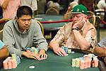 Shi Jia Liu and Dan Harrington in a hand.