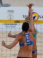 Jennifer Kessy, of the United States, back to camera, in action against Talita Antunes da Rocha during the women's final match between Brazil and United States at the Beach Volleyball World Tour Grand Slam, Foro Italico, Rome, 23 June 2013. Brazil defeated United States 2-1.<br /> UPDATE IMAGES PRESS/Isabella Bonotto