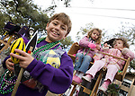 Jason Sumich, 9, holds his Mardi Gras swag from the Carrollton Krewe parade on St. Charles Avenue during the first weekend of Mardi Gras parades in New Orleans. His sisters, Hayley, 6, and Kaitlin, 3, get a great view from their ladder chari behind him.