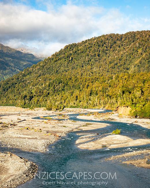 Waitangitahuna River with mountain background, Westland Tai Poutini National Park, UNESCO World Heritage Area, West Coast, New Zealand, NZ