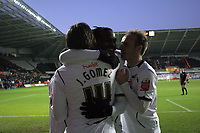 Pictured: (L-R) Jordi Gomez, Jason Scotalnd and Thomas Butler of Swansea City Celebrate<br />