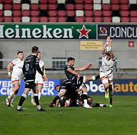 26 February 2021; Kieran Treadwell attempts to charge down Rhys Webb during the Guinness PRO14 match between Ulster and Ospreys at Kingspan Stadium in Belfast. Photo by John Dickson/Dicksondigital