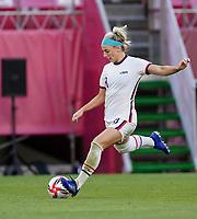 KASHIMA, JAPAN - JULY 27: Julie Ertz #8 of the United States sends a ball down field during a game between Australia and USWNT at Ibaraki Kashima Stadium on July 27, 2021 in Kashima, Japan.
