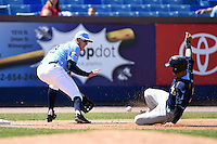Wilmington Blue Rocks third baseman Hunter Dozier (18) takes a throw as catcher Jorge Alfaro (24) slides in during a game against the Myrtle Beach Pelicans on April 27, 2014 at Frawley Stadium in Wilmington, Delaware.  Myrtle Beach defeated Wilmington 5-2.  (Mike Janes/Four Seam Images)