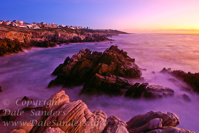 Crashing waves turn into an etheral mist in this long exposure at dusk at DeKelders near Gansbaii, South Africa.