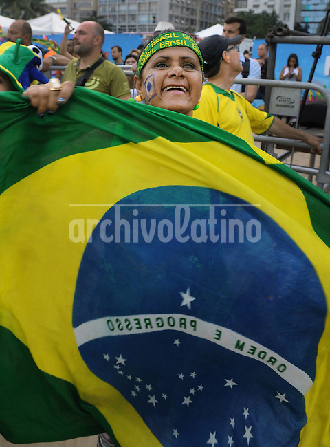 Brazil soccer fans or torcida celebrate in the beach of Copacabana their victory in the game against Cameroon