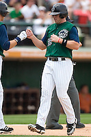 Charlotte Knights third baseman Josh fields (22) bumps fists with teammate Ryan Sweeney after scoring a run in the bottom of the first inning versus the Durham Bulls at Knights Stadium in Fort Mill, SC, Sunday, June 18, 2006.