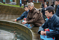Pictured: A woman places a poppy in the fountain. Saturday November 2017<br />