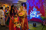 Hindu Coming of Age ritual celebration party London Uk Sixteen year old girl  wearing a veil for the first time with extended family.  Mitcham south London Uk They have arrived and entering her Ritusuddhi, also called as Ritu Kala Samskara party. HIndu God Ganesha Ganesh 2010s