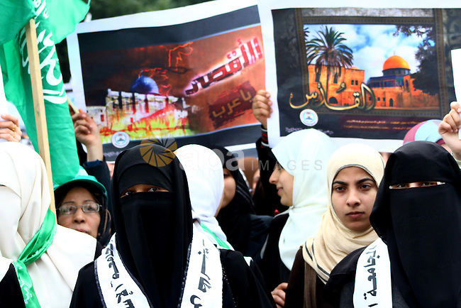 Palestinian women gather as they protest in Gaza City on February 26, 2012, two days following violence in the flashpoint Al-Aqsa mosque compound in Jerusalem's Old City, between Israeli forces and Palestinians. The unrest is believed to have been fuelled by web postings by Israeli rightists urging Jews to visit the mosque compound and assert Israeli sovereignty over the site, one of the most sensitive in the Middle East. Know to Muslims as Al-Haram Al-Sharif it considered the third holiest site in Islam, while it is known to Jews as the Temple Mount and is revered as Judaism's most sacred place. Photo by Ashraf Amra