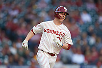 Brady Harlan (21) of the Oklahoma Sooners hustles down the first base line against the Arkansas Razorbacks in game two of the 2020 Shriners Hospitals for Children College Classic at Minute Maid Park on February 28, 2020 in Houston, Texas. The Sooners defeated the Razorbacks 6-3. (Brian Westerholt/Four Seam Images)