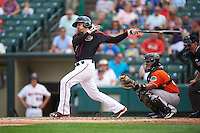 Rochester Red Wings catcher John Ryan Murphy (12) at bat in front of catcher Audry Perez (24) during a game against the Norfolk Tides on July 17, 2016 at Frontier Field in Rochester, New York.  Rochester defeated Norfolk 3-2.  (Mike Janes/Four Seam Images)