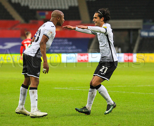 31st October 2020; Liberty Stadium, Swansea, Glamorgan, Wales; English Football League Championship Football, Swansea City versus Blackburn Rovers; Andre Ayew of Swansea City celebrates with Yan Dhanda after scoring his side second goal in the 61st minute to make the score 2-0