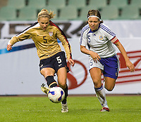 Tiina Salmen of Finland marks Lindsay Tarpley of the USA. The U.S. defeated Finland, 4-1 during the Four Nations Tournament in  Guangzhou, China on January 18, 2008.