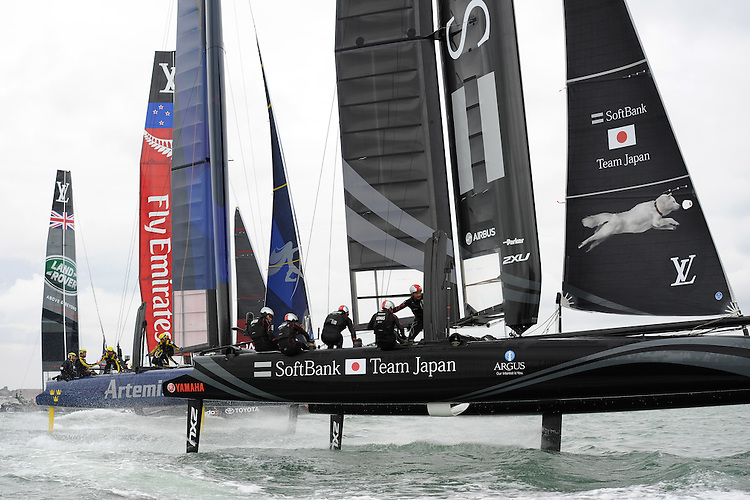 SoftBank Team Japan has the edge on Artemis Racing and Emirates Team New Zealand during day two of the Louis Vuitton America's Cup World Series racing, Portsmouth, United Kingdom. (Photo by Rob Munro/Stewart Communications)