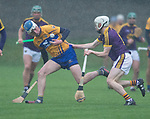 Diarmuid Ryan of Clare in action against David Dunne of Wexford during the Jack Lynch Memorial game at Tulla. Photograph by John Kelly.
