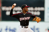 Kannapolis Intimidators shortstop Tim Anderson (2) makes a throw to first base against the Greenville Drive at CMC-Northeast Stadium on June 29, 2013 in Kannapolis, North Carolina.  The Drive defeated the Intimidators 5-3.   (Brian Westerholt/Four Seam Images)