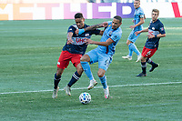 FOXBOROUGH, MA - SEPTEMBER 19: Brandon Bye #15 of New England Revolution and Alexander Callens #6 of New York City FC battle for the ball during a game between New York City FC and New England Revolution at Gillette on September 19, 2020 in Foxborough, Massachusetts.