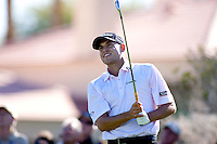 Bill Haas uses an iron for his approach to the 18th green on the final round of the 2010 Bob Hope Classic.