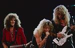 Whitesnake performing at St Louis Arena, St Louis, Mo . July 1987. Vivian Campbell, David Coverdale, Adrian Vandenberg.