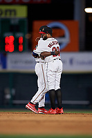 Rochester Red Wings Nick Gordon (1) and Jordany Valdespin (23) hug after closing out an International League game against the Scranton/Wilkes-Barre RailRiders on June 24, 2019 at Frontier Field in Rochester, New York.  Rochester defeated Scranton 8-6.  (Mike Janes/Four Seam Images)