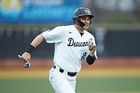 Michael Ludowig (22) of the Wake Forest Demon Deacons hustles towards home plate against the Sacred Heart Pioneers at David F. Couch Ballpark on February 15, 2019 in  Winston-Salem, North Carolina.  The Demon Deacons defeated the Pioneers 14-1.  (Brian Westerholt/Four Seam Images)