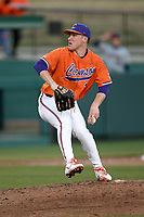 Relief pitcher Geoffrey Gilbert (31) of the Clemson Tigers delivers a pitch in a game against the Stony Brook Seawolves on Friday, February 21, 2020, at Doug Kingsmore Stadium in Clemson, South Carolina. Clemson won, 2-0. (Tom Priddy/Four Seam Images)