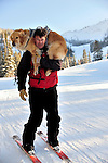 Crested Butte ski patrolman Russ Reycraft and his avalanche rescue lab, Betty.   Sometimes he carries Betty to a rescue so her energy isn't depleted before a search.  When on the snow, the dogs are trained to run between the patrollers legs, to protect them from being hit by other skiers and boarders.