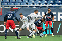 FOXBOROUGH, MA - APRIL 17: Emiliano Terzaghi #32 of Richmond Kickers breaks away from  Christian Malfa #38 of New England Revolution II during a game between Richmond Kickers and Revolution II at Gillette Stadium on April 17, 2021 in Foxborough, Massachusetts.