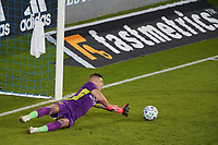 SAN JOSE, CA - OCTOBER 03: David Bingham #1 of the Los Angeles Galaxy dives for a ball during a game between Los Angeles Galaxy and San Jose Earthquakes at Earthquakes Stadium on October 03, 2020 in San Jose, California.