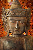 Wooden Buddha carving.