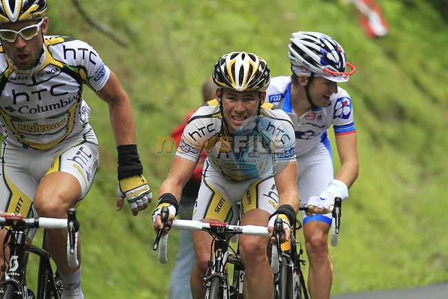 The grupetto including Bernhard Eisel (AUT) leading Mark Cavendish (GBR) HTC-Columbia approach the summit of the Cat 1 climb at Col du Marie Blanque during a wet foggy Stage 17 of the 2010 Tour de France running 174km from Pau to Col du Tourmalet, France. 22nd July 2010.<br /> (Photo by Eoin Clarke/NEWSFILE).<br /> All photos usage must carry mandatory copyright credit (© NEWSFILE | Eoin Clarke)