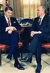 President Ronald Reagan looks at watch while Soveit Leader Gorbachev looks on, USA President Ronald Reagan and Soviet Leader Mikhail Gorbachev summit, Reagan Gorbachev, Summit,