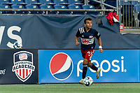 FOXBOROUGH, MA - AUGUST 21: Colby Quinones #41 of New England Revolution II dribbles down the wing during a game between Richmond Kickers and New England Revolution II at Gillette Stadium on August 21, 2020 in Foxborough, Massachusetts.