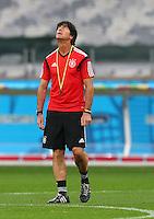 Germany coach Joachim Loew looks to the sky during training ahead of tomorrow's semi final vs Brazil
