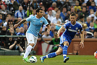 Carlos Tevez (32) Manchester City watched by Gary Cahill Chelsea..Manchester City defeated Chelsea 4-3 in an international friendly at Busch Stadium, St Louis, Missouri.