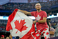 5th September 2021; Nashville, TN, USA;  A Canadian fan waves the Canadian flag during a CONCACAF World Cup qualifying match between the United States and Canada on September 5, 2021 at Nissan Stadium in Nashville, TN.